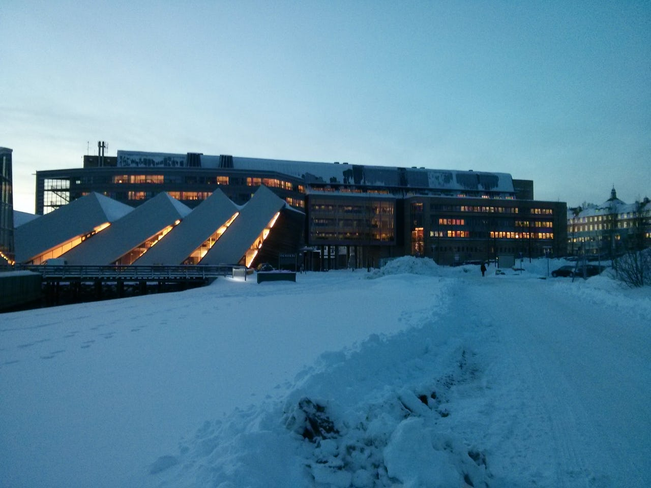 Evening view on building covered by snow