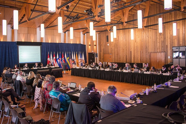 Senior Arctic Officials sitting at table in Whitehorse October 2013