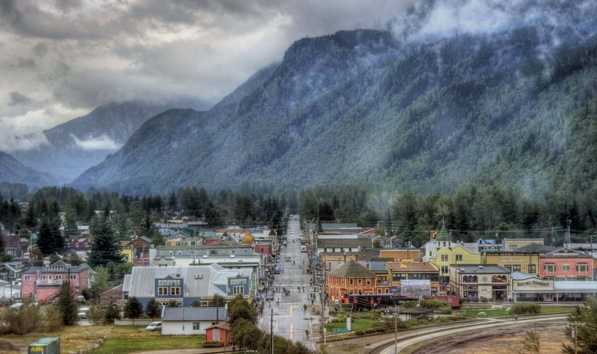 Small town, its main street and mountains in the back