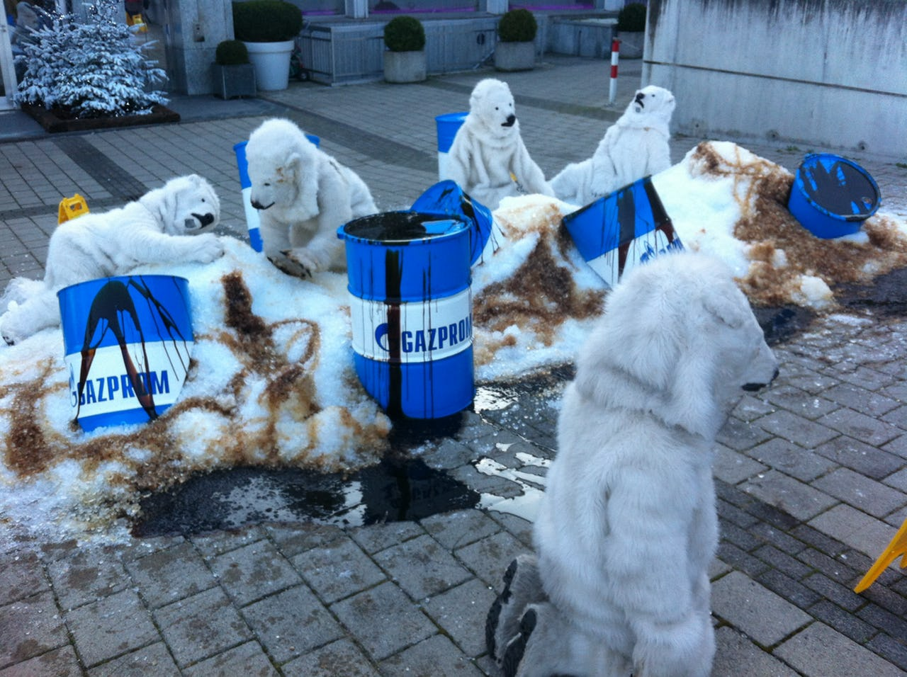 People dressed-up as polar bears protesting
