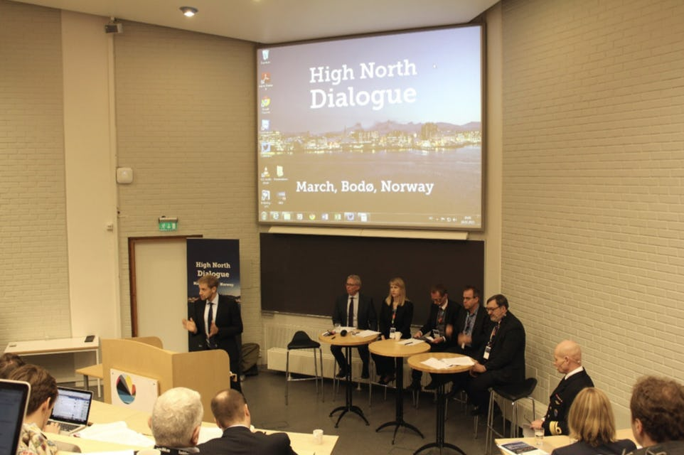 People discussing at High North Dialogue