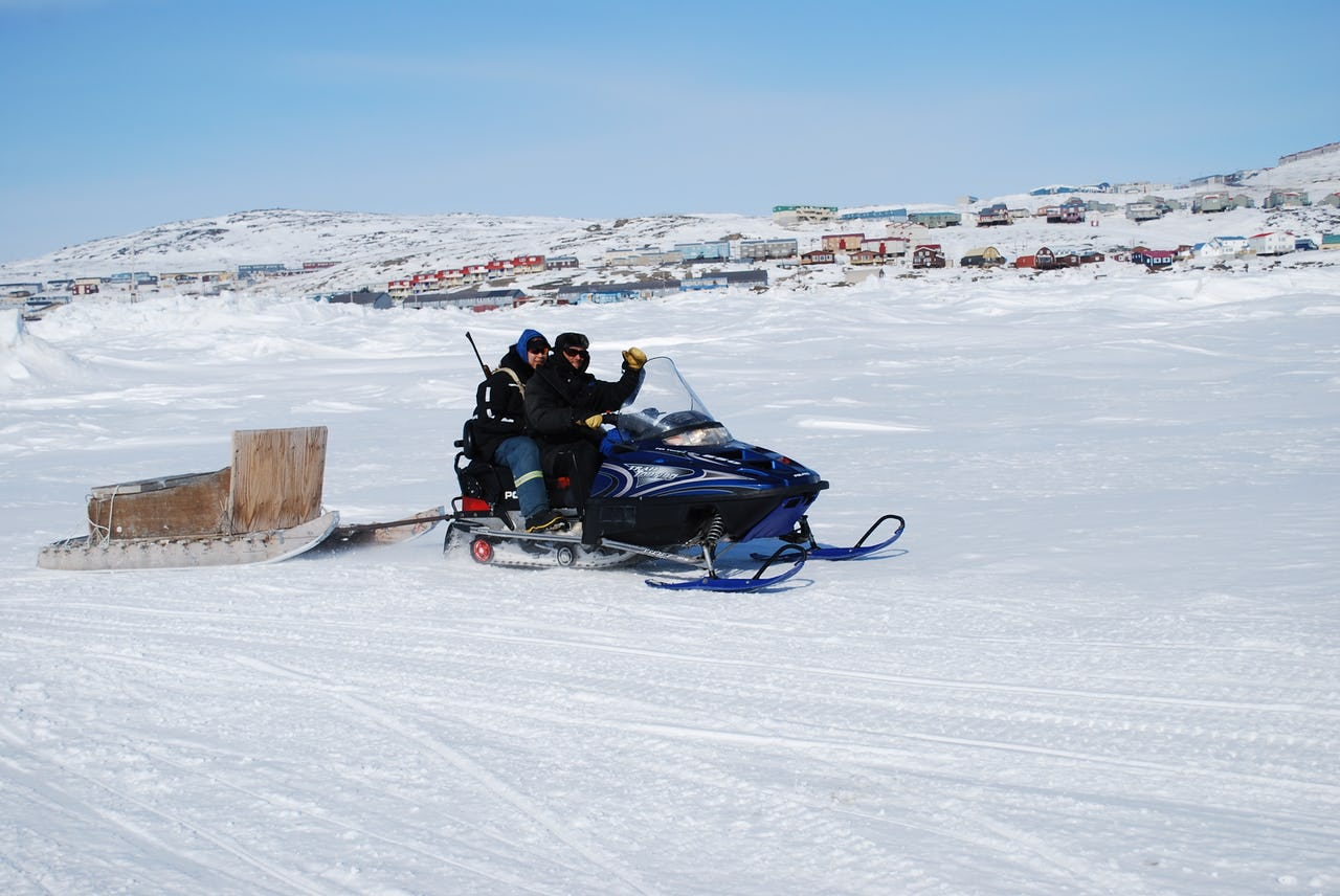 Snowmobile ride in Frobisher Bay, Iqaluit on a sunny day