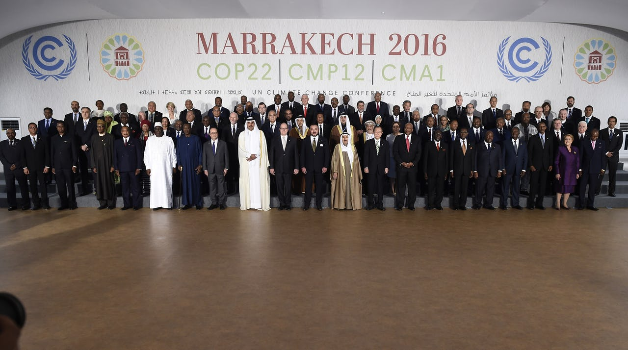 Head of States standing on podium in front of COP22 logo in Marrakesh, Morocco in November 2016.