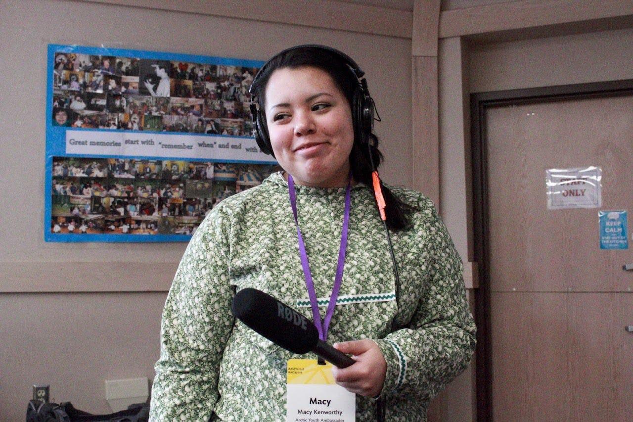 Female youth ambassador conducting interviews