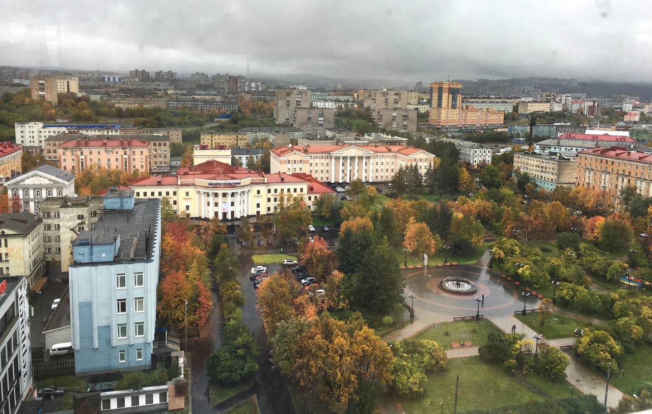 Buildings and park in Murmansk with grey sky.