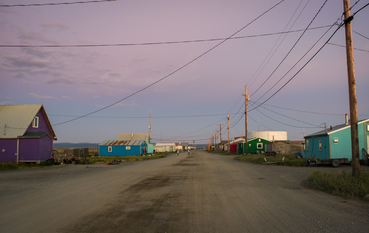 The town of Shaktoolik and its main street at sunset