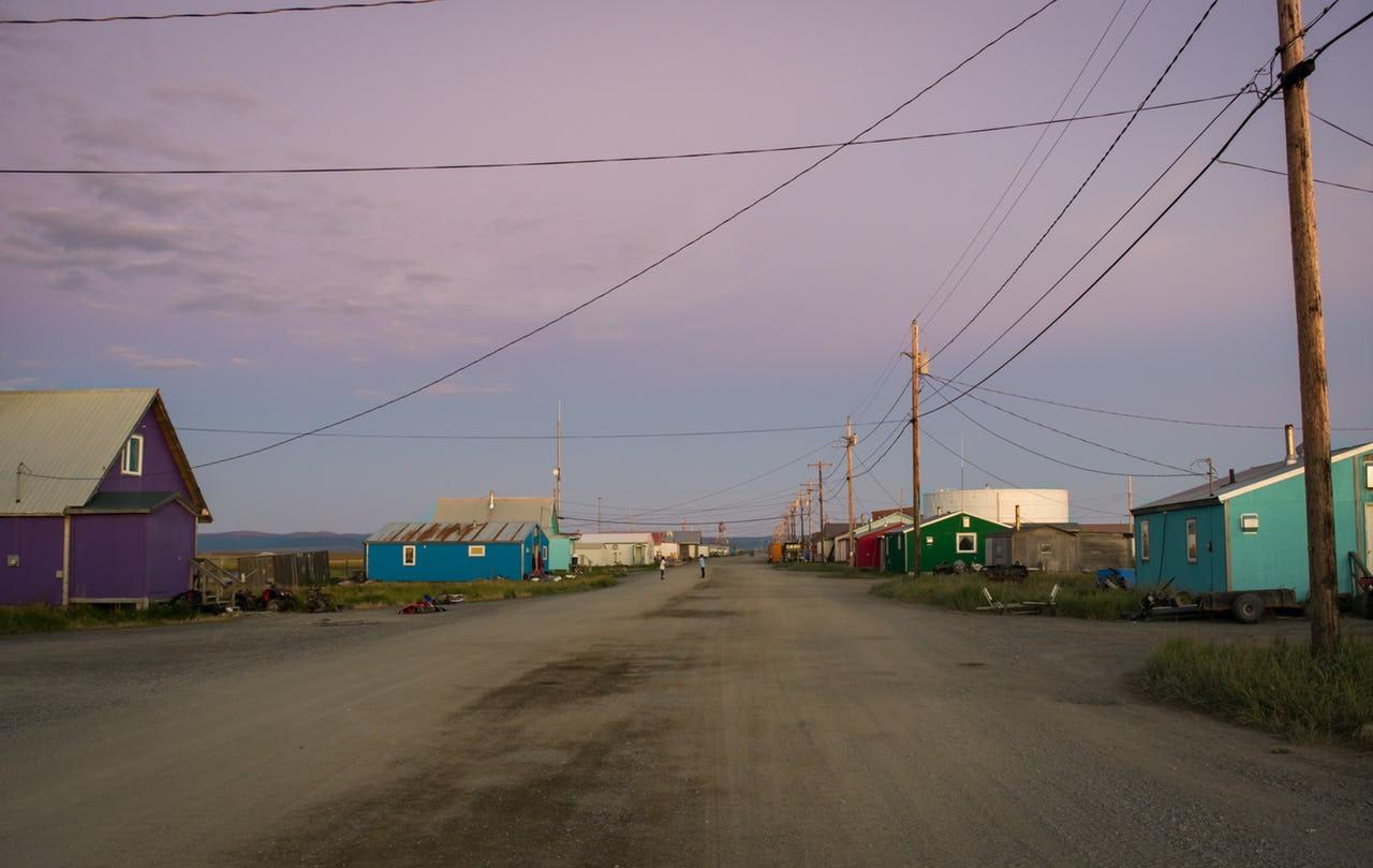 The town of Shaktoolik and its main street at sunset