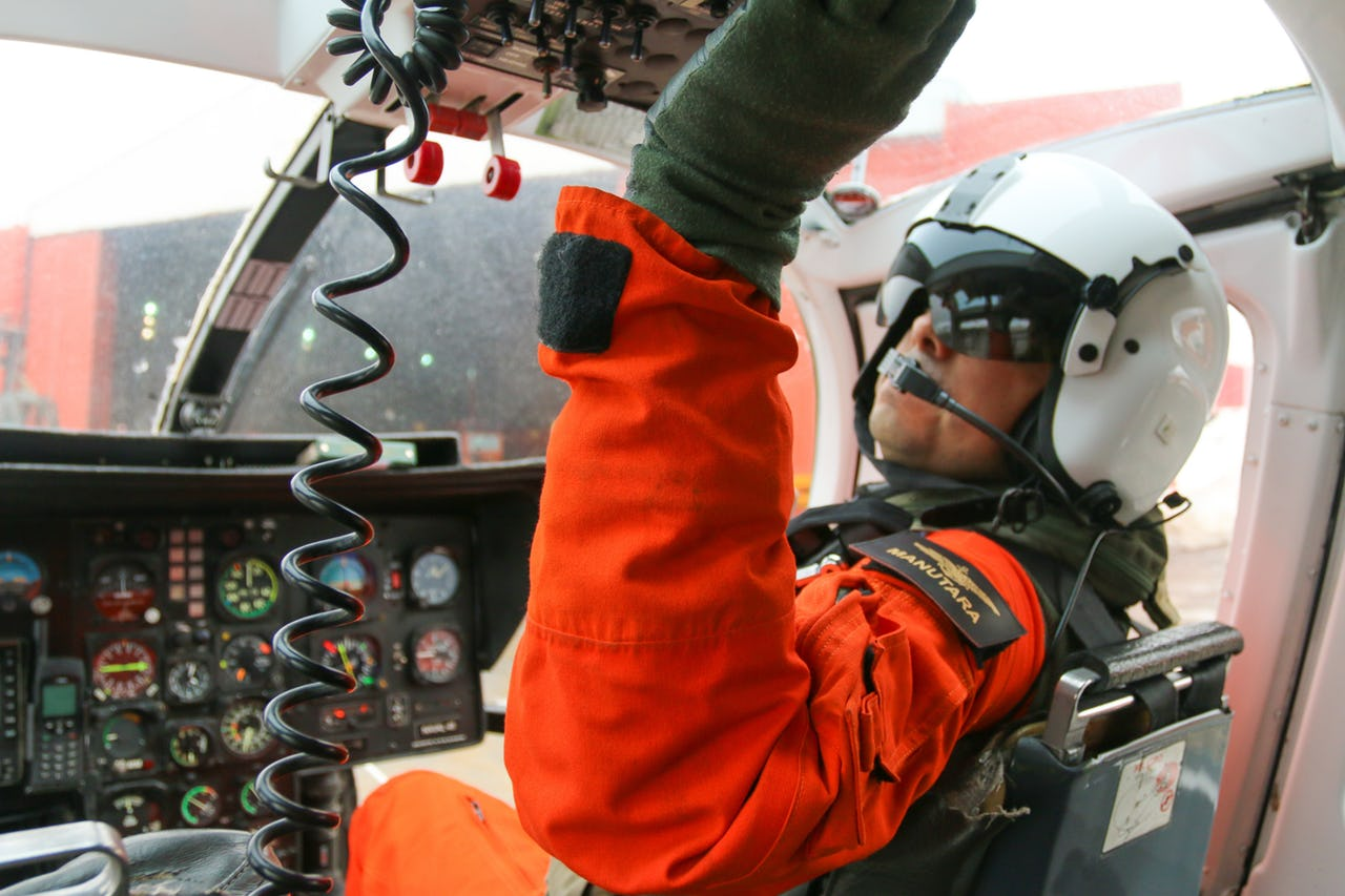 Pilot in helicopter cockpit before start