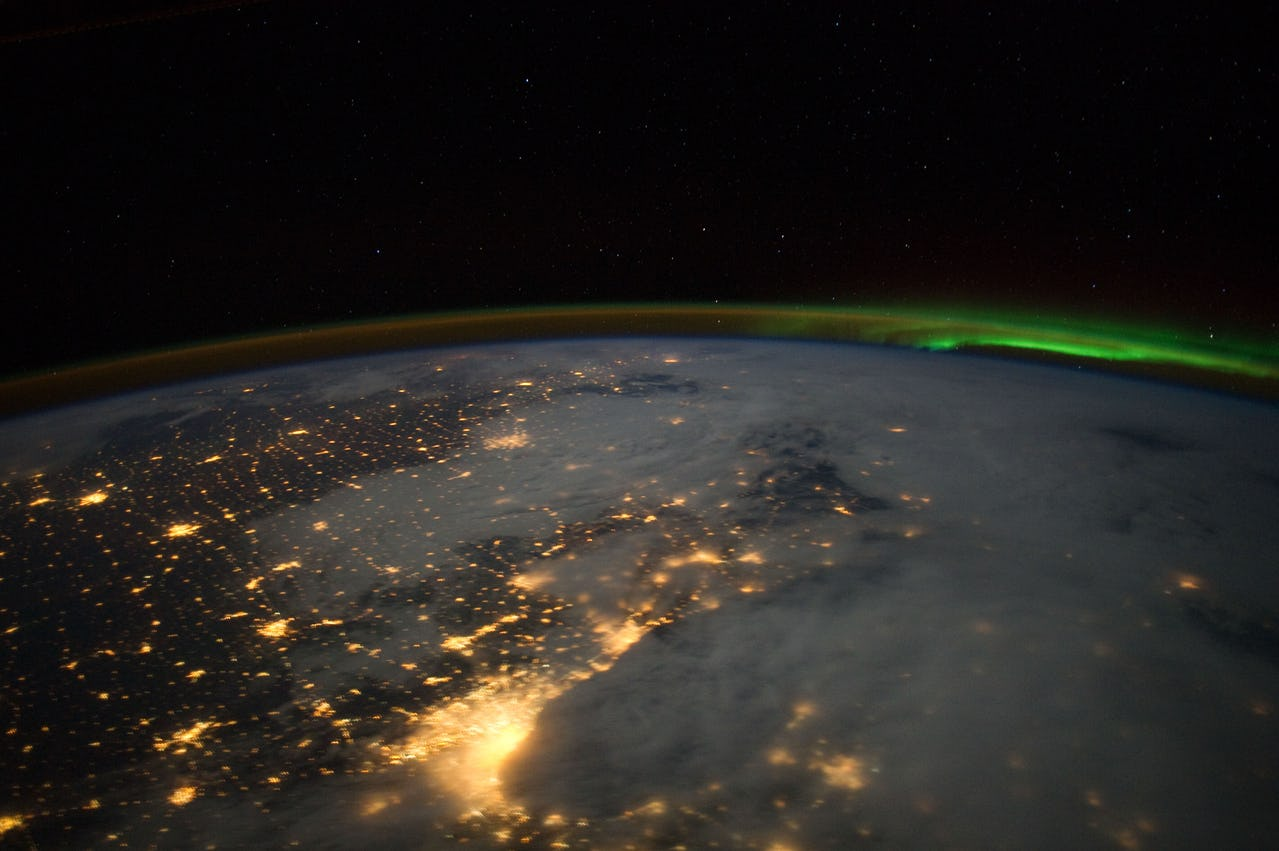 View of parts of the earth from space with minor auroral activity (borealis)