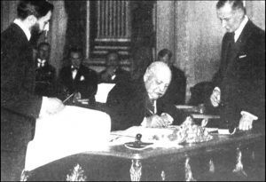 Black and white image of men signing a treaty